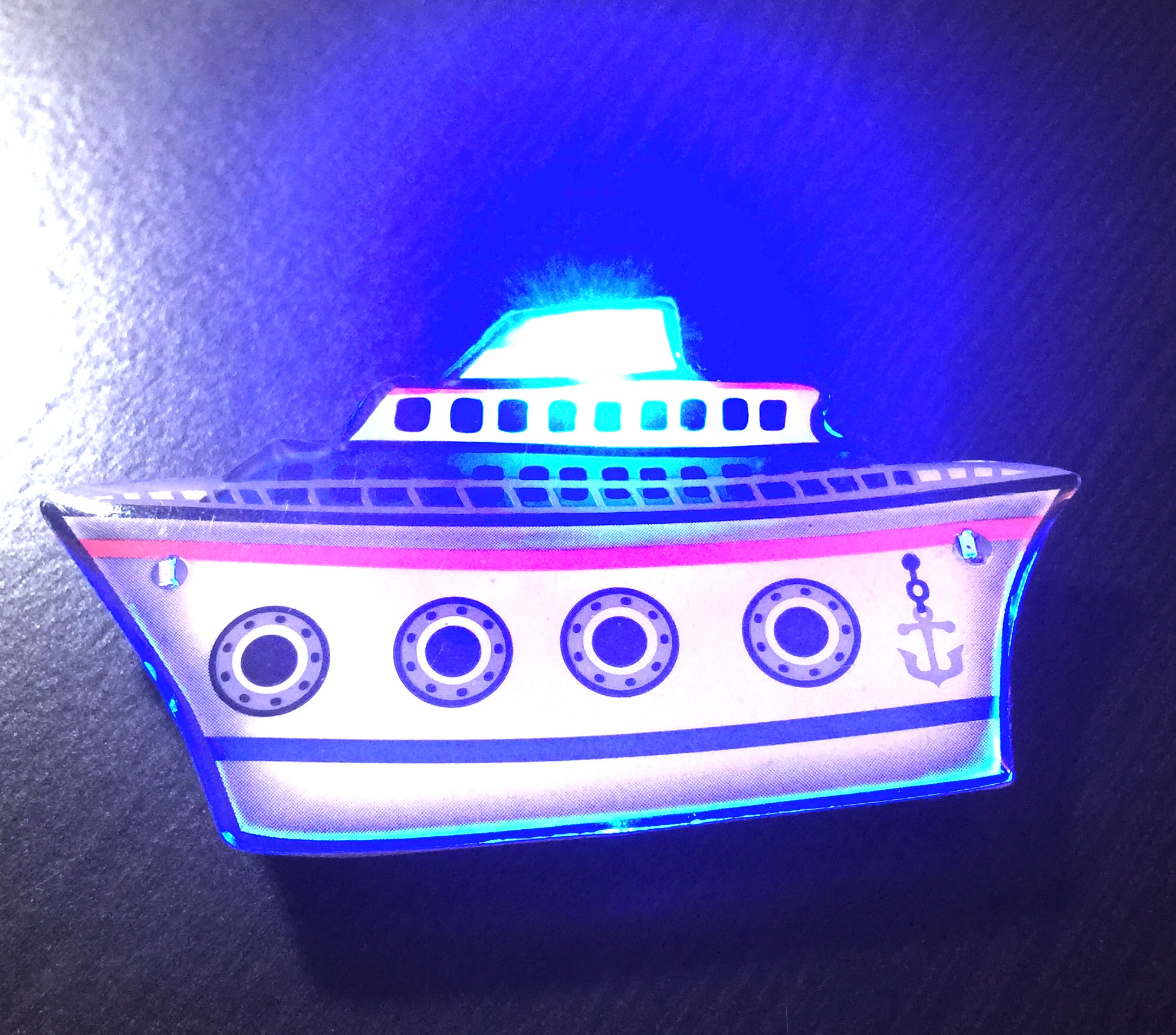 lapel pin of blinking ship